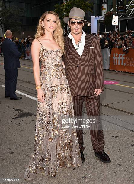 Actress Amber Heard and actor Johnny Depp attend 'The Danish Girl' premiere during the 2015 Toronto International Film Festival at the Princess of...