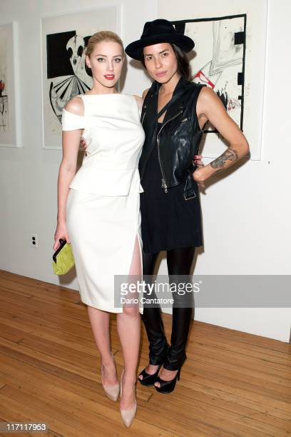Actress Amber Heard and artist Tasya Van Ree attends Tasya Van Ree's private viewing of 'Distorted Delicacies' at Vs Magazine Creative Studios Paris'...