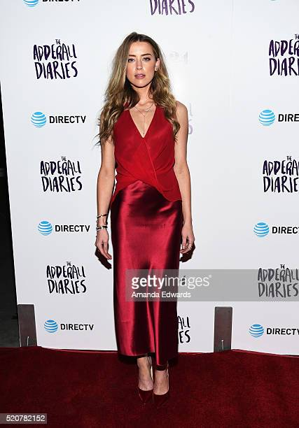 Actress Amber Heard arrives at A24/DIRECTV's 'The Adderall Diaires' premiere at the ArcLight Hollywood on April 12 2016 in Hollywood California