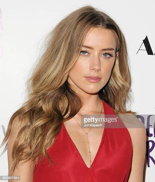 Actress Amber Heard arrives at A24/DIRECTV's 'The Adderall Diaires' Premiere at ArcLight Hollywood on April 12 2016 in Hollywood California