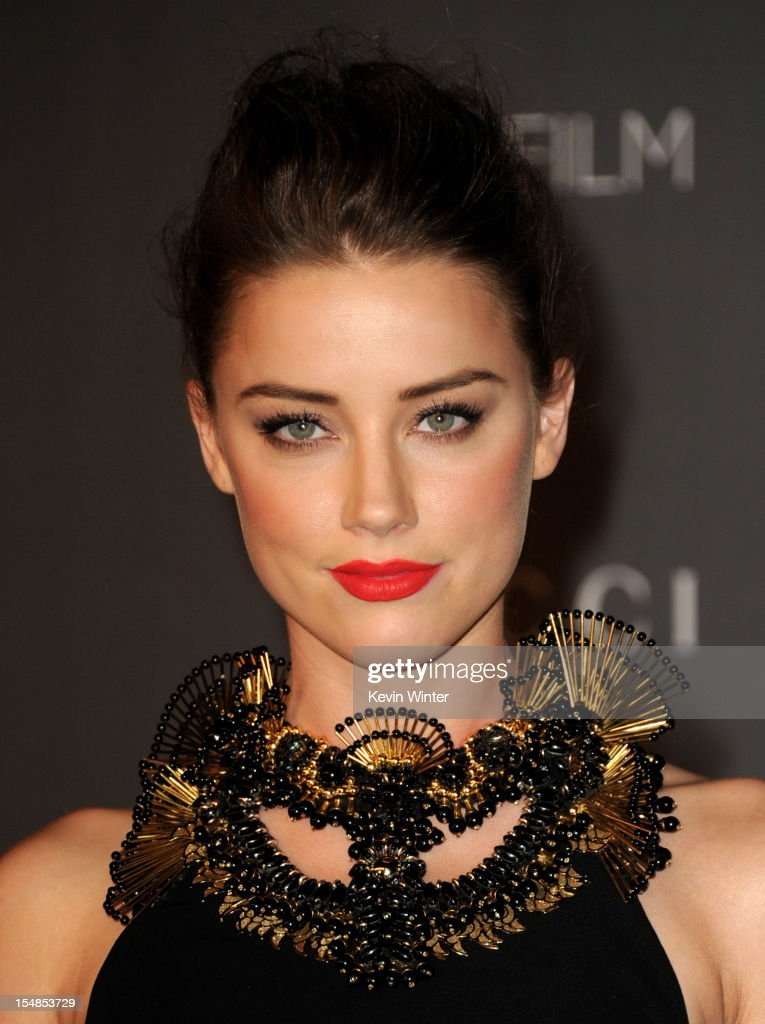 Actress <a gi-track='captionPersonalityLinkClicked' href=/galleries/search?phrase=Amber+Heard&family=editorial&specificpeople=2210577 ng-click='$event.stopPropagation()'>Amber Heard</a> arrives at LACMA 2012 Art + Film Gala at LACMA on October 27, 2012 in Los Angeles, California.