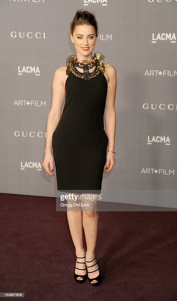 Actress <a gi-track='captionPersonalityLinkClicked' href=/galleries/search?phrase=Amber+Heard&family=editorial&specificpeople=2210577 ng-click='$event.stopPropagation()'>Amber Heard</a> arrives at LACMA Art + Gala at LACMA on October 27, 2012 in Los Angeles, California.
