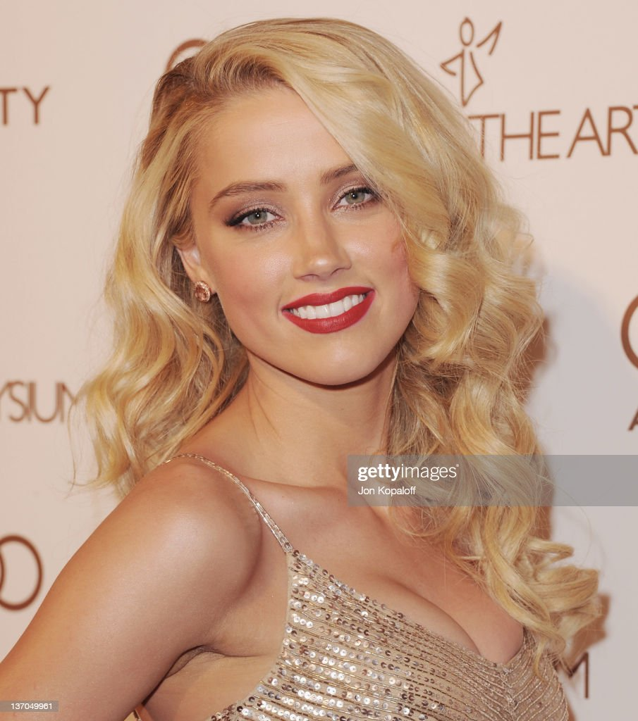 Actress Amber Heard arrives at the Art Of Elysium's 5th Annual Heaven Gala at Union Station on January 14, 2012 in Los Angeles, California.