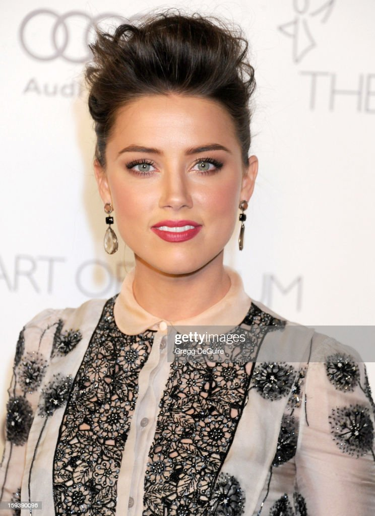 Actress <a gi-track='captionPersonalityLinkClicked' href=/galleries/search?phrase=Amber+Heard&family=editorial&specificpeople=2210577 ng-click='$event.stopPropagation()'>Amber Heard</a> arrives at The Art of Elysium's Heaven Gala at 2nd Street Tunnel on January 12, 2013 in Los Angeles, California.