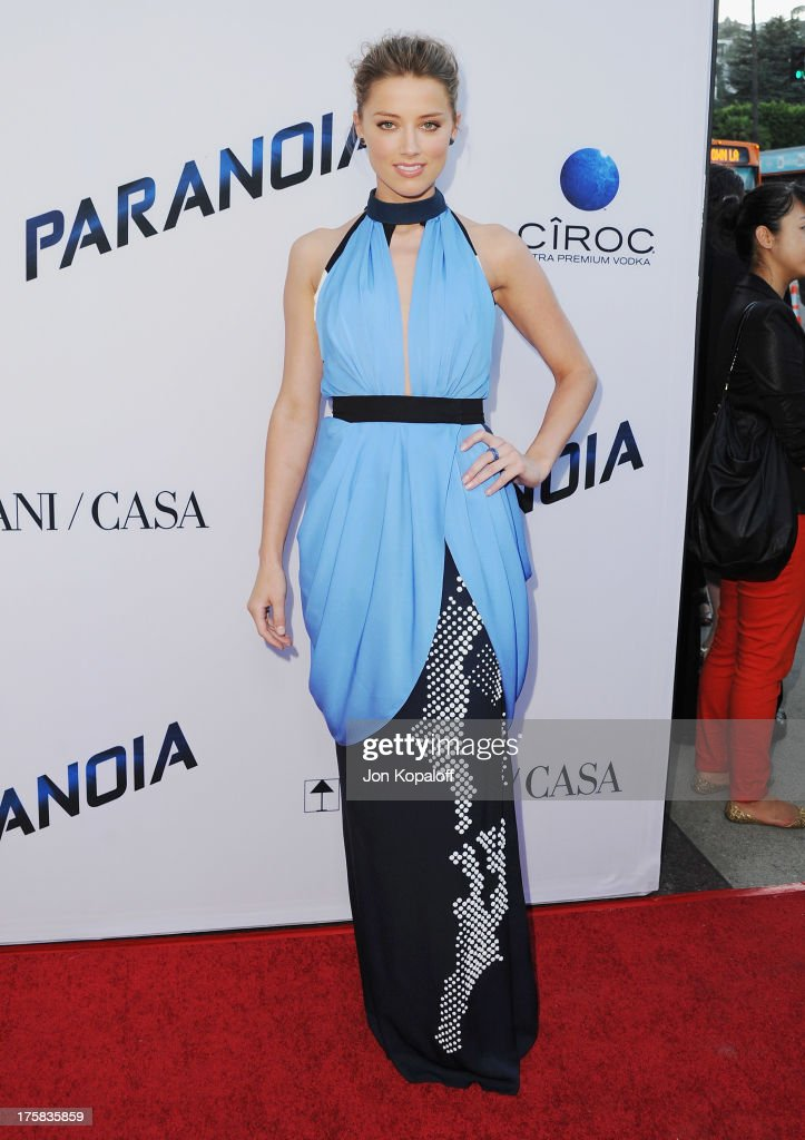 Actress Amber Heard arrives at the Los Angeles Premiere 'Paranoia' at DGA Theater on August 8, 2013 in Los Angeles, California.