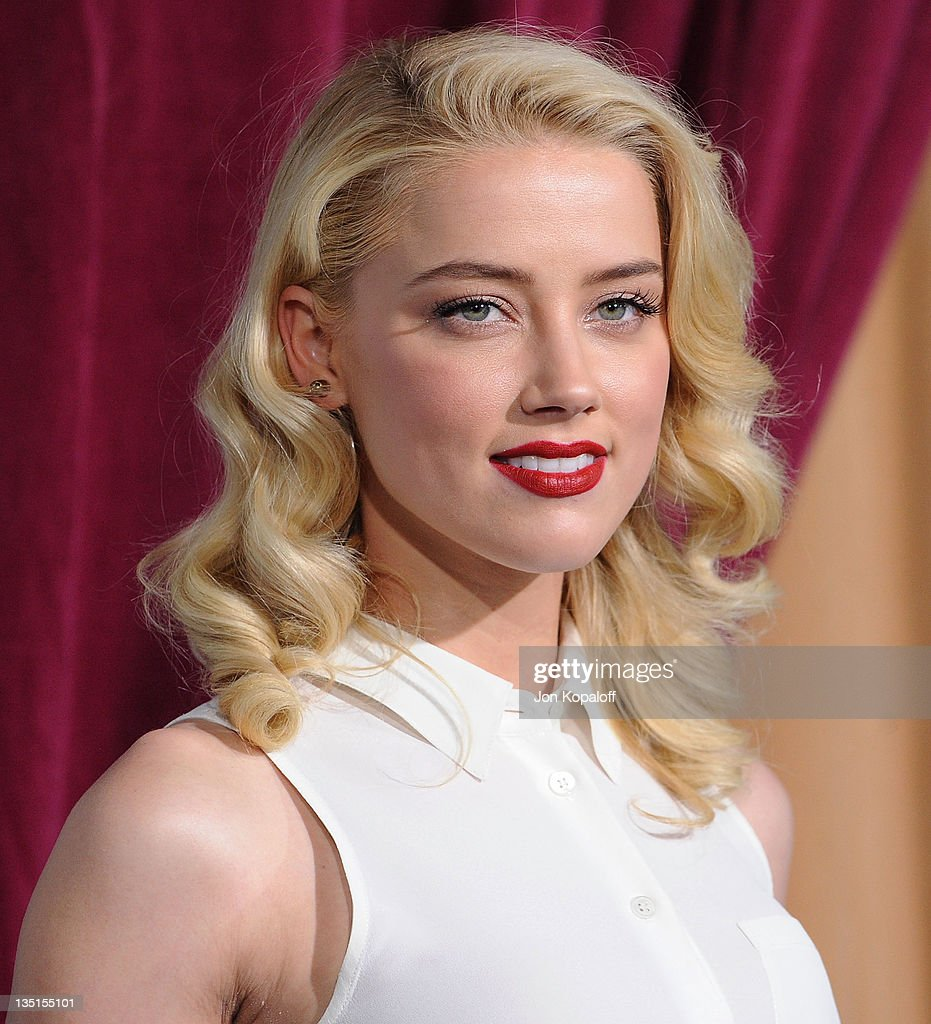 Actress Amber Heard arrives at the Los Angeles Premiere 'Sherlock Holmes A Game Of Shadows' at Regency Village Theatre on December 6 2011 in Westwood...
