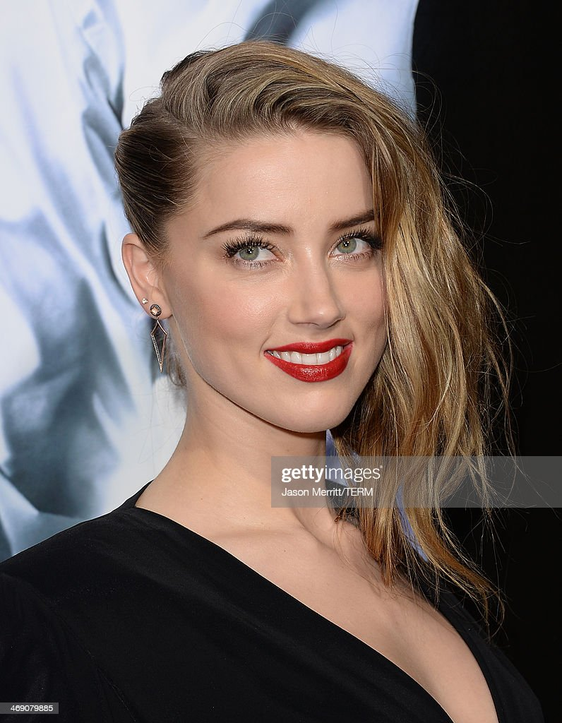 Actress Amber Heard arrives at the premiere of '3 Days to Kill' at ArcLight Cinemas on February 12, 2014 in Hollywood, California.