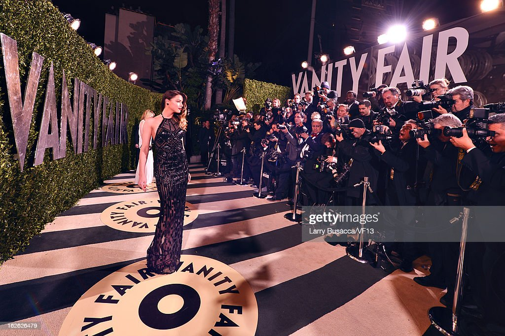 Actress <a gi-track='captionPersonalityLinkClicked' href=/galleries/search?phrase=Amber+Heard&family=editorial&specificpeople=2210577 ng-click='$event.stopPropagation()'>Amber Heard</a> arrives for the 2013 Vanity Fair Oscar Party hosted by Graydon Carter at Sunset Tower on February 24, 2013 in West Hollywood, California.