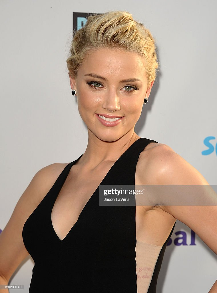 Actress <a gi-track='captionPersonalityLinkClicked' href=/galleries/search?phrase=Amber+Heard&family=editorial&specificpeople=2210577 ng-click='$event.stopPropagation()'>Amber Heard</a> attends NBC's 2011 TCA summer press tour at The Bazaar at the SLS Hotel on August 1, 2011 in Los Angeles, California.