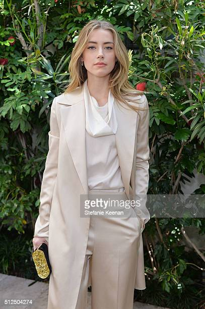 Actress Amber Heard attends NETAPORTER Celebrates Women Behind The Lens at Chateau Marmont on February 26 2016 in Los Angeles California