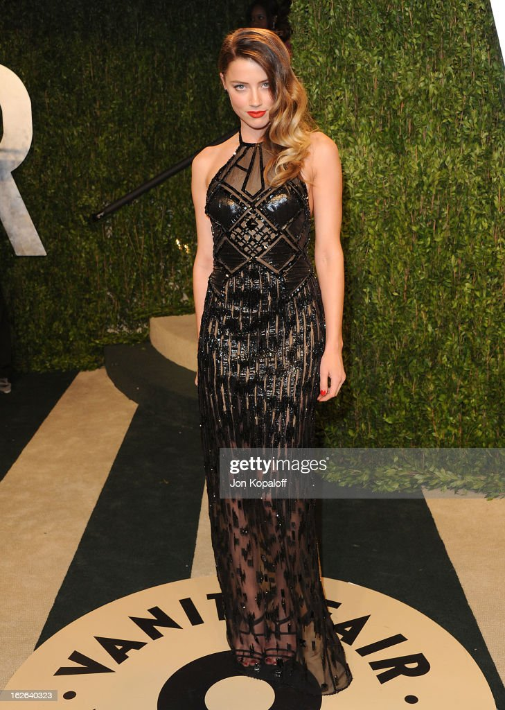 Actress <a gi-track='captionPersonalityLinkClicked' href=/galleries/search?phrase=Amber+Heard&family=editorial&specificpeople=2210577 ng-click='$event.stopPropagation()'>Amber Heard</a> attends the 2013 Vanity Fair Oscar party at Sunset Tower on February 24, 2013 in West Hollywood, California.