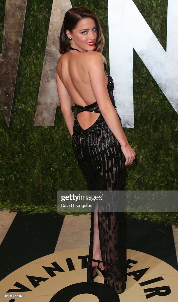 Actress <a gi-track='captionPersonalityLinkClicked' href=/galleries/search?phrase=Amber+Heard&family=editorial&specificpeople=2210577 ng-click='$event.stopPropagation()'>Amber Heard</a> attends the 2013 Vanity Fair Oscar Party at the Sunset Tower Hotel on February 24, 2013 in West Hollywood, California.
