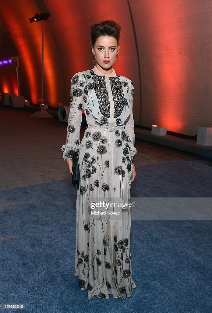 Actress <a gi-track='captionPersonalityLinkClicked' href=/galleries/search?phrase=Amber+Heard&family=editorial&specificpeople=2210577 ng-click='$event.stopPropagation()'>Amber Heard</a> attends The Art of Elysium's 6th Annual HEAVEN Gala After Party presented by Audi at 2nd Street Tunnel on January 12, 2013 in Los Angeles, California.