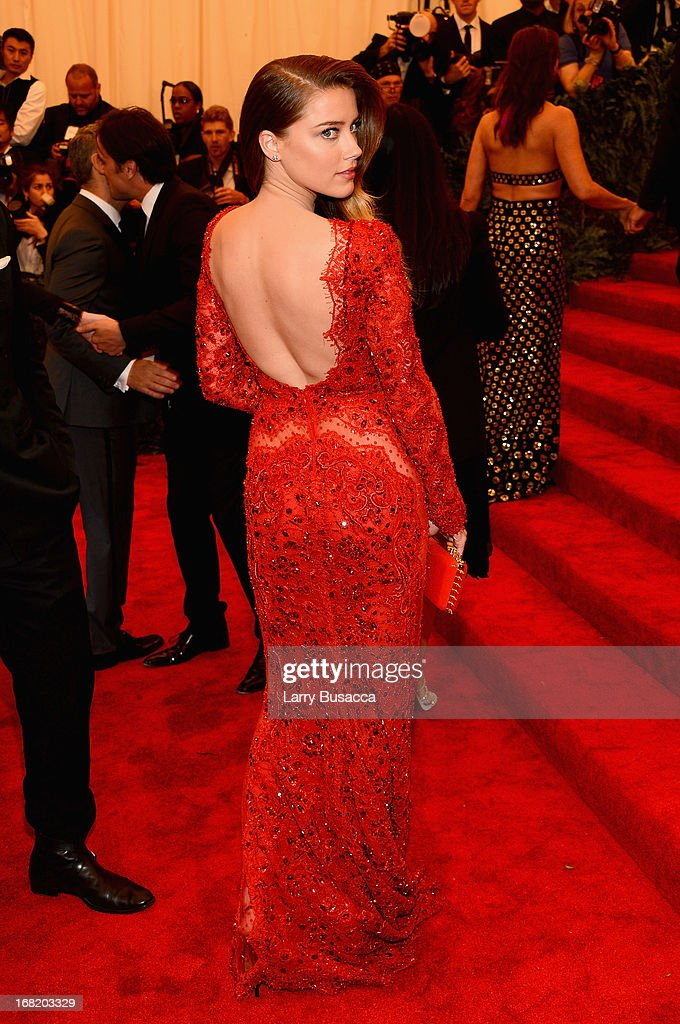 Actress Amber Heard attends the Costume Institute Gala for the 'PUNK Chaos to Couture' exhibition at the Metropolitan Museum of Art on May 6 2013 in...
