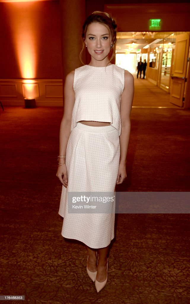 Actress <a gi-track='captionPersonalityLinkClicked' href=/galleries/search?phrase=Amber+Heard&family=editorial&specificpeople=2210577 ng-click='$event.stopPropagation()'>Amber Heard</a> attends the Hollywood Foreign Press Association's 2013 Installation Luncheon at The Beverly Hilton Hotel on August 13, 2013 in Beverly Hills, California.