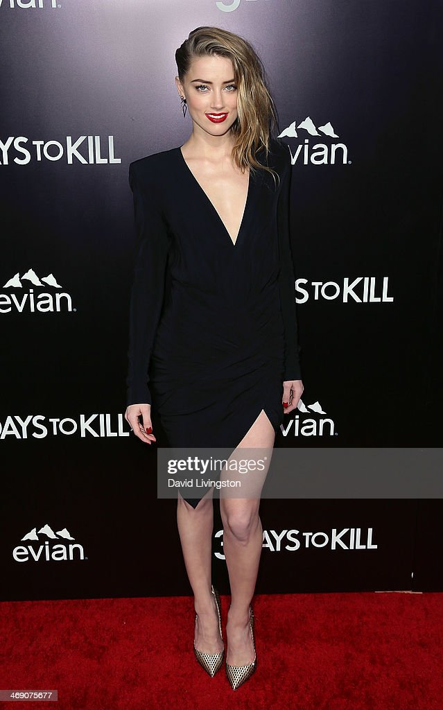 Actress <a gi-track='captionPersonalityLinkClicked' href=/galleries/search?phrase=Amber+Heard&family=editorial&specificpeople=2210577 ng-click='$event.stopPropagation()'>Amber Heard</a> attends the premiere of Relativity Media's '3 Days to Kill' at ArcLight Cinemas on February 12, 2014 in Hollywood, California.