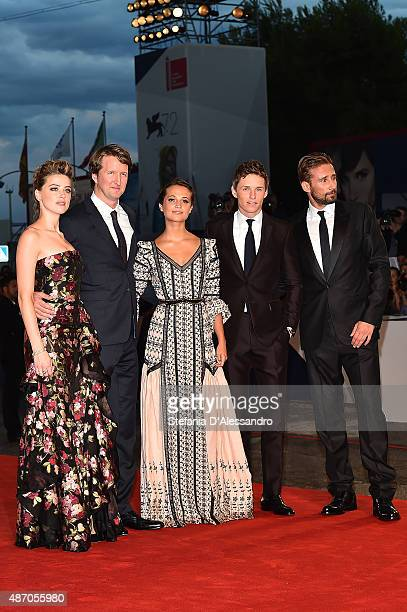Actress Amber Heard director Tom Hooper actors Alicia Vikander Eddie Redmayne and Matthias Schoenaerts attend a premiere for 'A Danish Girl' during...