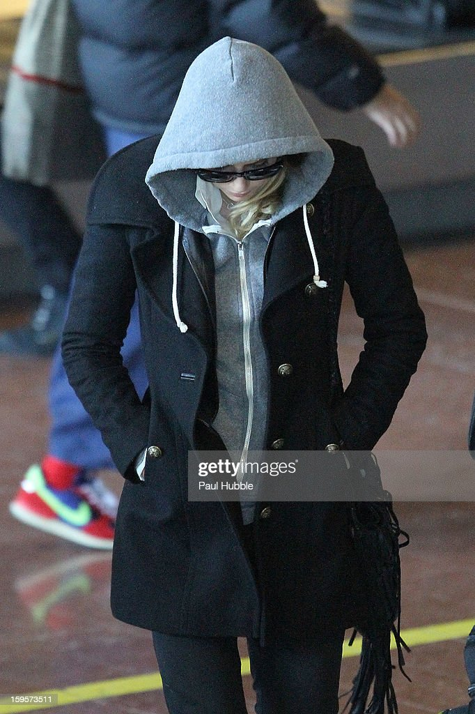Actress Amber Heard is seen arriving at Roissy airport on January 16, 2013 in Paris, France.