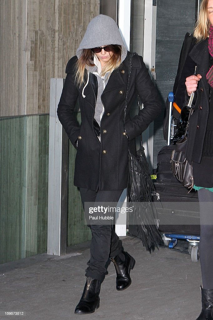 Actress <a gi-track='captionPersonalityLinkClicked' href=/galleries/search?phrase=Amber+Heard&family=editorial&specificpeople=2210577 ng-click='$event.stopPropagation()'>Amber Heard</a> is seen arriving at Roissy airport on January 16, 2013 in Paris, France.