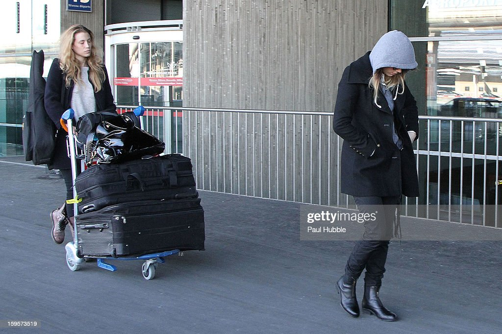 Actress Amber Heard (R) is seen arriving at Roissy airport on January 16, 2013 in Paris, France.
