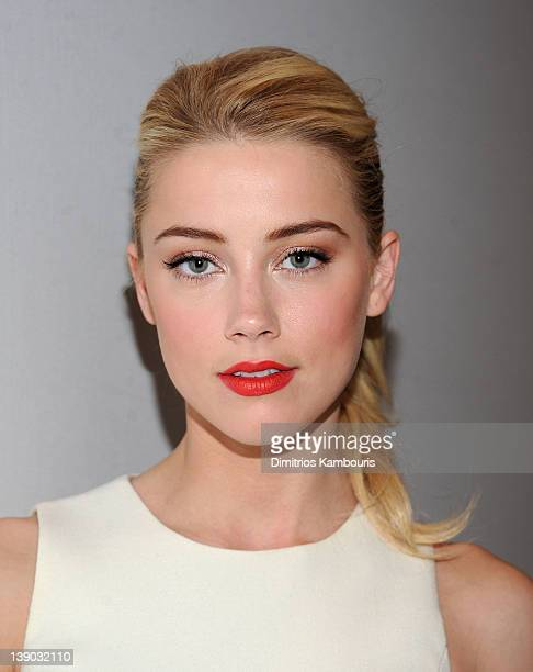 Actress Amber Heard poses backstage at the Michael Kors Fall 2012 fashion show during MercedesBenz Fashion Week at The Theatre at Lincoln Center on...