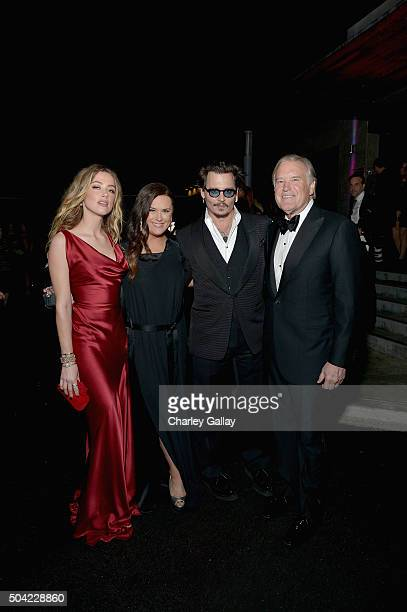Actress Amber Heard The Art of Elysium founder Jennifer Howell actor Johnny Depp and The Art of Elysium chairman of the board Tim Headington attend...