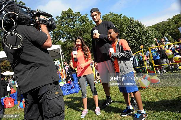 Actress Amber Montana NBA Player Brook Lopez and actor Curtis Harris speak as kids and families enjoy the activities at Nickelodeon's 10th Annual...