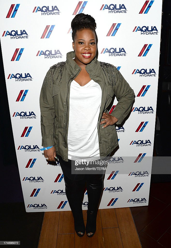 Actress <a gi-track='captionPersonalityLinkClicked' href=/galleries/search?phrase=Amber+Riley&family=editorial&specificpeople=5662111 ng-click='$event.stopPropagation()'>Amber Riley</a> attends a private event at Hyde Lounge for the Bruno Mars & Ellie Goulding concert hosted by AQUAhydrate at The Staples Center on July 27, 2013 in Los Angeles, California.
