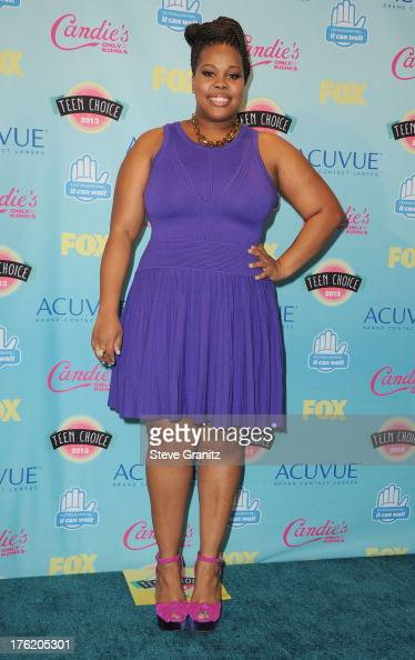 Actress Amber Riley poses in the press room at the 2013 Teen Choice Awards at Gibson Amphitheatre on August 11 2013 in Universal City California