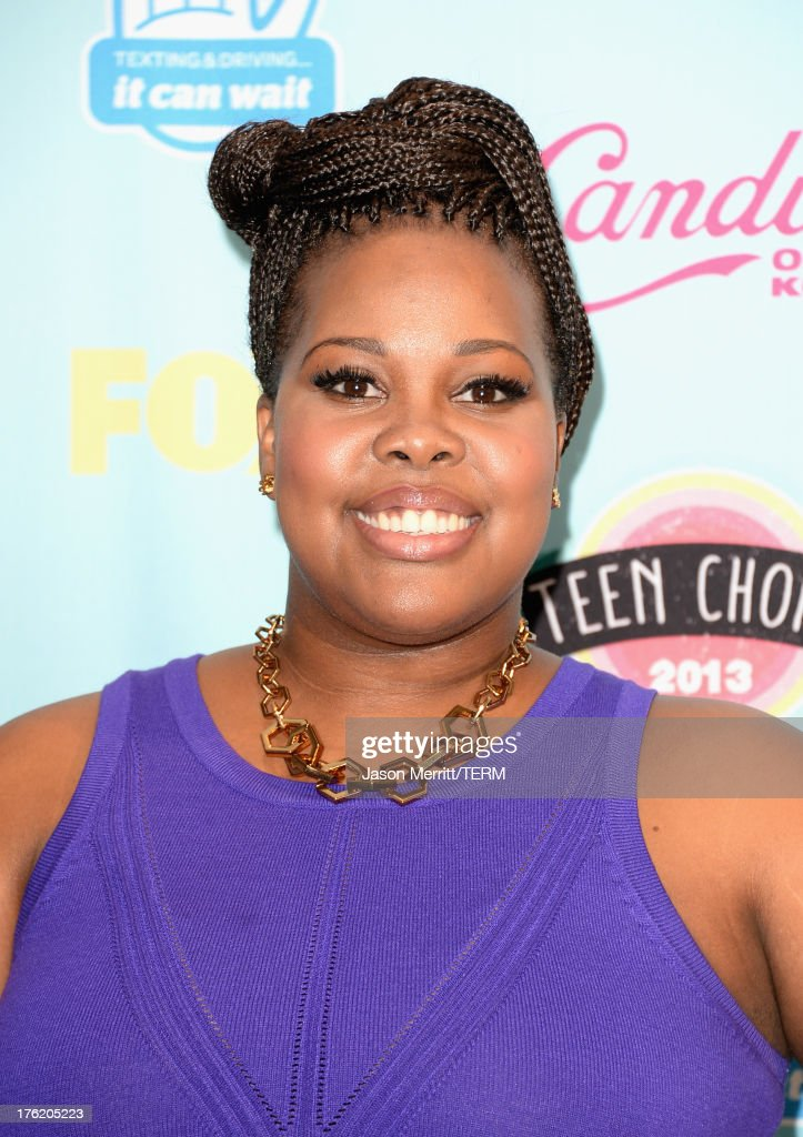 Actress <a gi-track='captionPersonalityLinkClicked' href=/galleries/search?phrase=Amber+Riley&family=editorial&specificpeople=5662111 ng-click='$event.stopPropagation()'>Amber Riley</a>, winner of Choice TV Show: Comedy for 'Glee,' attends the Teen Choice Awards 2013 at Gibson Amphitheatre on August 11, 2013 in Universal City, California.