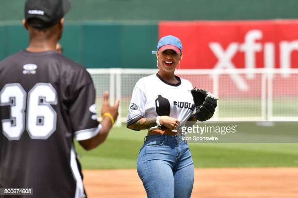 Actress Amber Rose jokes around JaVale McGees JUGLIFE charity softball game on June 24 at OaklandAlameda County Coliseum in Oakland CA