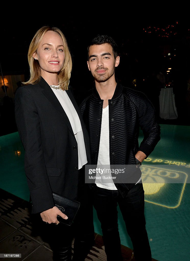 Actress <a gi-track='captionPersonalityLinkClicked' href=/galleries/search?phrase=Amber+Valletta&family=editorial&specificpeople=206940 ng-click='$event.stopPropagation()'>Amber Valletta</a> (L) and actor/singer <a gi-track='captionPersonalityLinkClicked' href=/galleries/search?phrase=Joe+Jonas&family=editorial&specificpeople=842712 ng-click='$event.stopPropagation()'>Joe Jonas</a> attend Cotton Incorporated's Blue Jeans Go Green celebrates 1 million pieces of denim collected for recycling at SkyBar at the Mondrian Los Angeles on November 6, 2013 in West Hollywood, California.