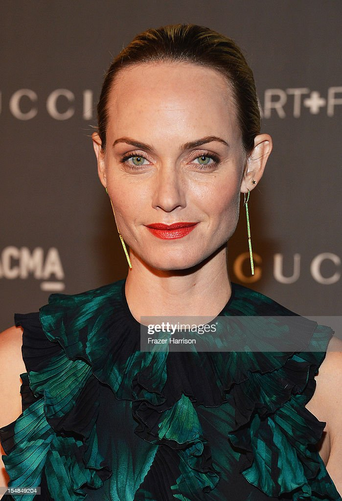 Actress Amber Valletta arrives at LACMA 2012 Art + Film Gala Honoring Ed Ruscha and Stanley Kubrick presented by Gucci at LACMA on October 27, 2012 in Los Angeles, California.