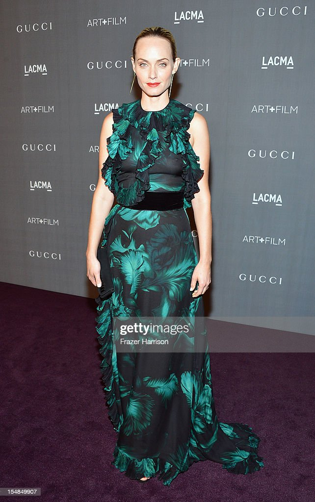 Actress <a gi-track='captionPersonalityLinkClicked' href=/galleries/search?phrase=Amber+Valletta&family=editorial&specificpeople=206940 ng-click='$event.stopPropagation()'>Amber Valletta</a> arrives at LACMA 2012 Art + Film Gala Honoring Ed Ruscha and Stanley Kubrick presented by Gucci at LACMA on October 27, 2012 in Los Angeles, California.