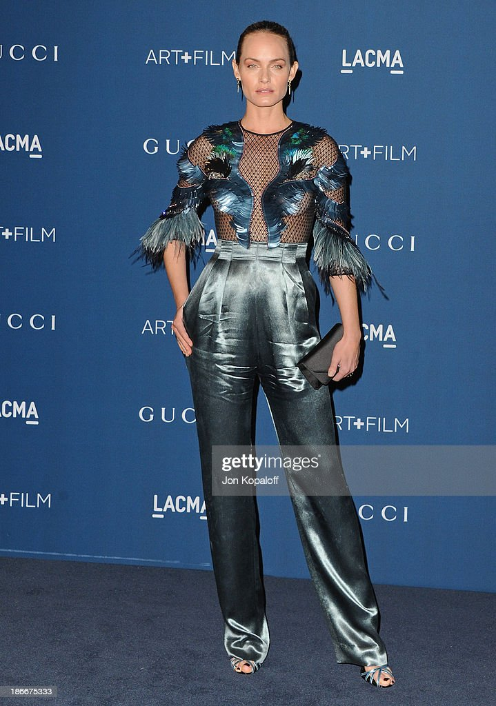 Actress <a gi-track='captionPersonalityLinkClicked' href=/galleries/search?phrase=Amber+Valletta&family=editorial&specificpeople=206940 ng-click='$event.stopPropagation()'>Amber Valletta</a> arrives at LACMA 2013 Art + Film Gala at LACMA on November 2, 2013 in Los Angeles, California.