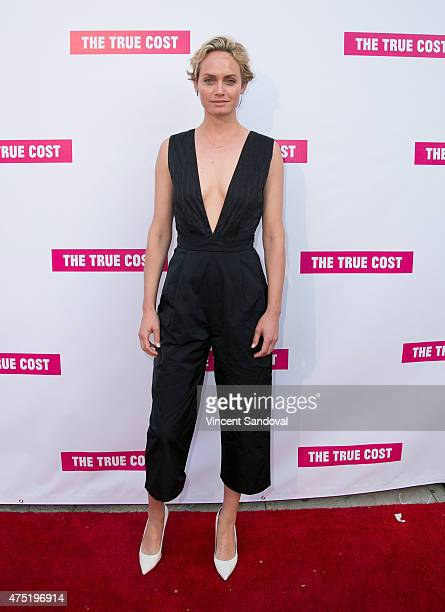 Actress Amber Valletta attends the Los Angeles premiere of 'The True Cost' at Laemmle's Music Hall 3 on May 29 2015 in Beverly Hills California