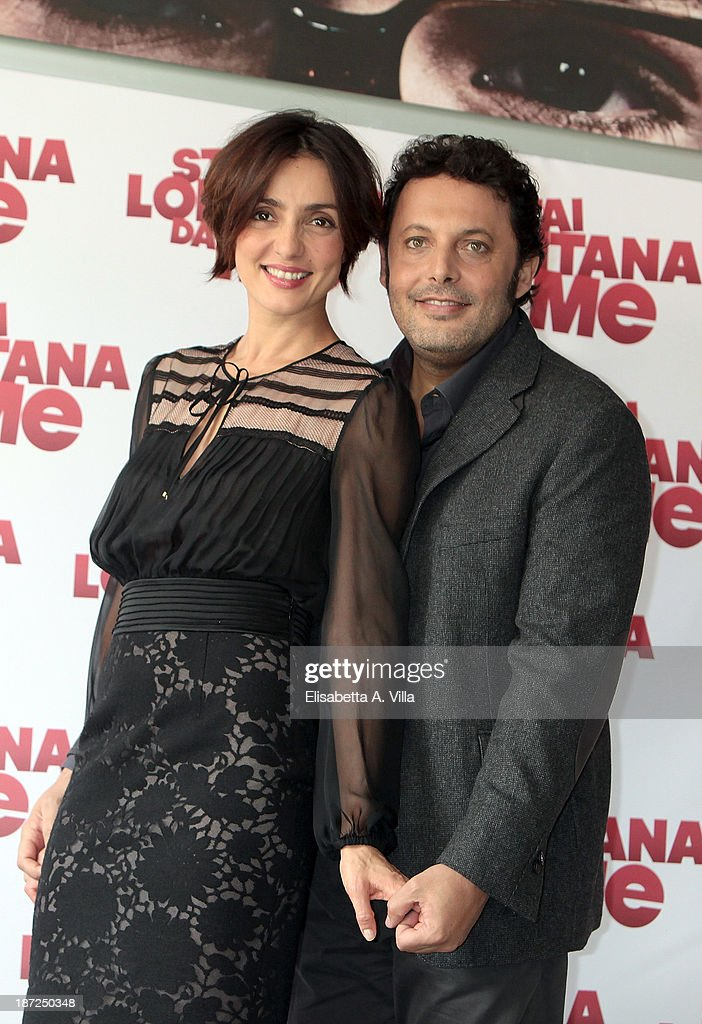 Actress <a gi-track='captionPersonalityLinkClicked' href=/galleries/search?phrase=Ambra+Angiolini&family=editorial&specificpeople=4333551 ng-click='$event.stopPropagation()'>Ambra Angiolini</a> and actor <a gi-track='captionPersonalityLinkClicked' href=/galleries/search?phrase=Enrico+Brignano&family=editorial&specificpeople=676896 ng-click='$event.stopPropagation()'>Enrico Brignano</a> attend 'Stai Lontana Da me' photocall at Cinema Adriano on November 7, 2013 in Rome, Italy.