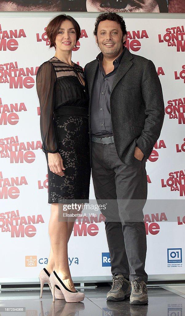 Actress Ambra Angiolini and actor Enrico Brignano attend 'Stai Lontana Da me' photocall at Cinema Adriano on November 7, 2013 in Rome, Italy.