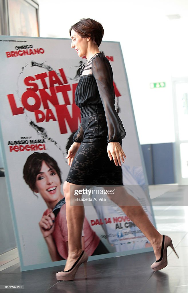 Actress <a gi-track='captionPersonalityLinkClicked' href=/galleries/search?phrase=Ambra+Angiolini&family=editorial&specificpeople=4333551 ng-click='$event.stopPropagation()'>Ambra Angiolini</a> attends 'Stai Lontana Da me' photocall at Cinema Adriano on November 7, 2013 in Rome, Italy.