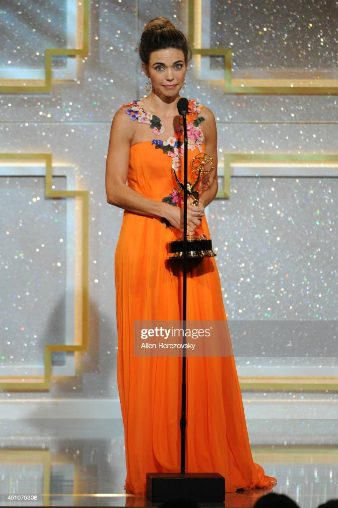 Actress <a gi-track='captionPersonalityLinkClicked' href=/galleries/search?phrase=Amelia+Heinle&family=editorial&specificpeople=3276082 ng-click='$event.stopPropagation()'>Amelia Heinle</a> accepts an Emmy Award during the 41st Annual Daytime Emmy Awards at The Beverly Hilton Hotel on June 22, 2014 in Beverly Hills, California.
