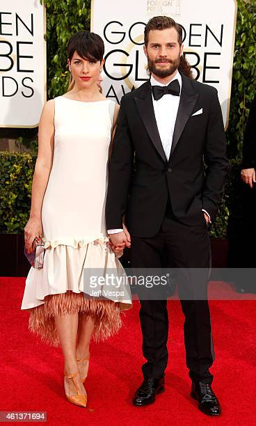 Actress Amelia Warner and actor Jamie Dornan attend the 72nd Annual Golden Globe Awards at The Beverly Hilton Hotel on January 11 2015 in Beverly...