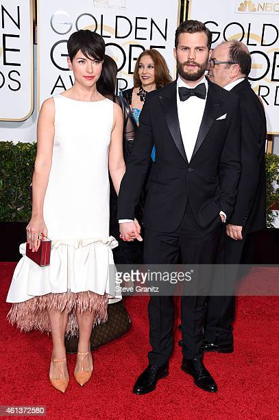 Actress Amelia Warner and Jamie Dornan attend the 72nd Annual Golden Globe Awards at The Beverly Hilton Hotel on January 11 2015 in Beverly Hills...