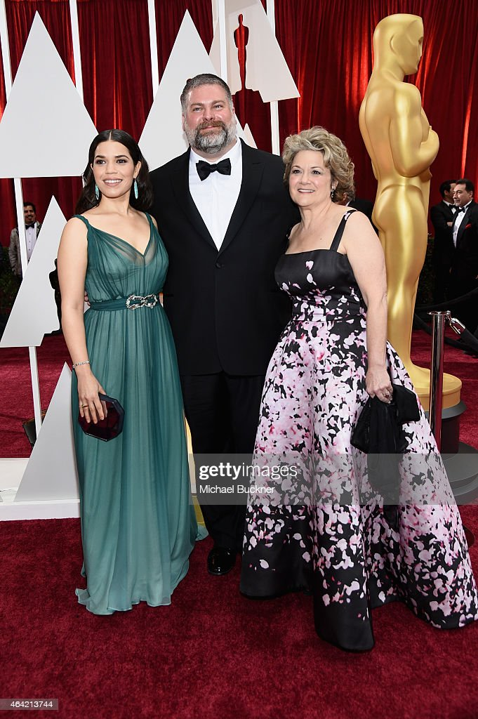 Actress America Ferrera, writer/director Dean DeBlois and producer Bonnie Arnold attends the 87th Annual Academy Awards at Hollywood & Highland Center on February 22, 2015 in Hollywood, California.