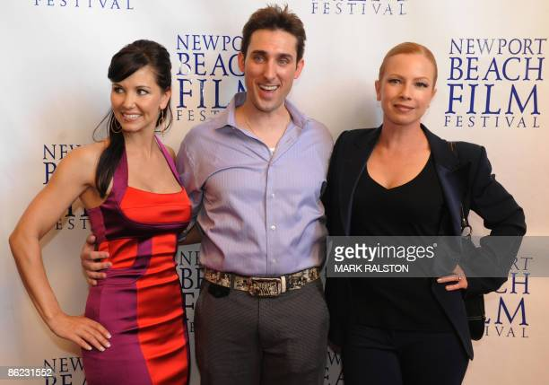 Actress Amie Barsky with producer/actor Paul Alessi and former porn star turned mainstream actress Traci Lords as they arrive for the premiere of the...