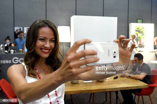 Actress Amy Acker of 'Person of Interest' takes a selfie at the Getty Images Portrait Studio Powered By Samsung Galaxy At ComicCon International 2015...