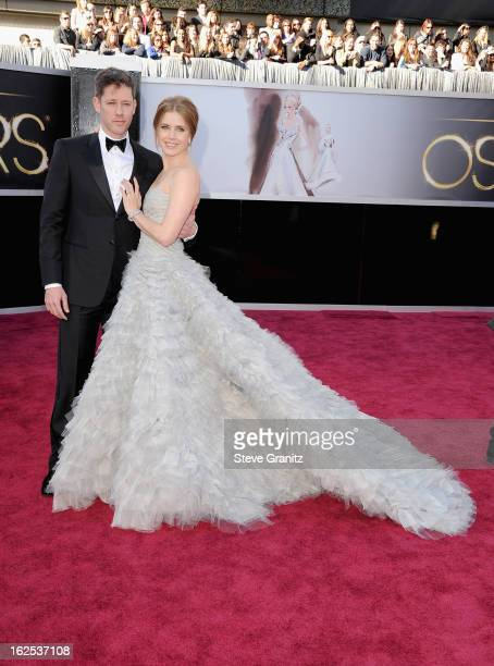 Actress Amy Adams and actor Darren Le Gallo arrive at the Oscars at Hollywood Highland Center on February 24 2013 in Hollywood California