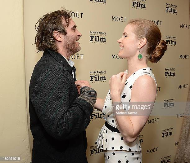 Actress Amy Adams and actor Joaquin Phoenix visit The Moet Chandon Lounge at The Santa Barbara International Film Festival on January 31 2013 in...