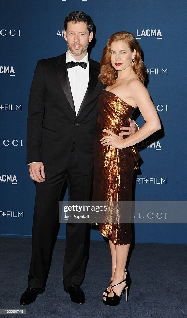 Actress Amy Adams and Darren Le Gallo arrive at LACMA 2013 Art + Film Gala at LACMA on November 2, 2013 in Los Angeles, California.