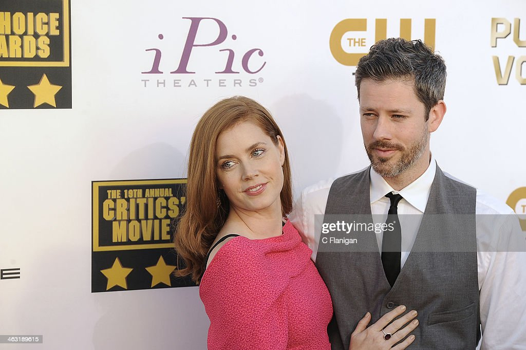 Actress Amy Adams and Darren Le Gallo arrive at the 19th Annual Critics' Choice Movie Awards at Barker Hangar on January 16, 2014 in Santa Monica, California.