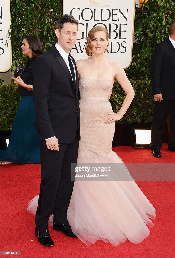 Actress Amy Adams (R) and Darren Le Gallo arrive at the 70th Annual Golden Globe Awards held at The Beverly Hilton Hotel on January 13, 2013 in Beverly Hills, California.
